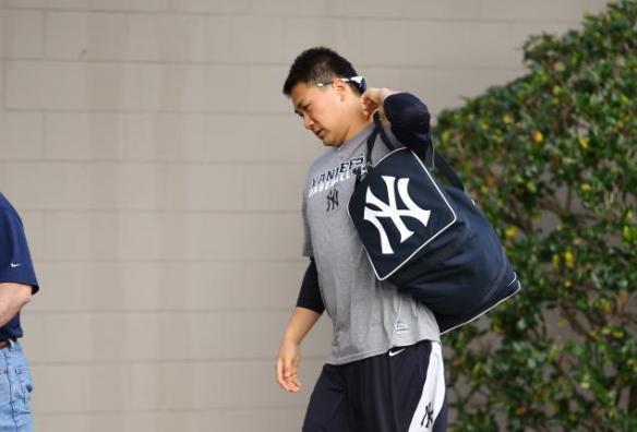 Masahiro Tanaka arrives in New York