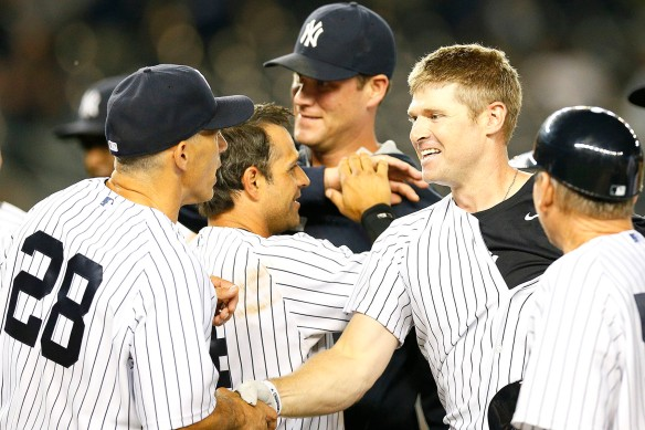 Chase Headley shakes hands with Joe Girardi