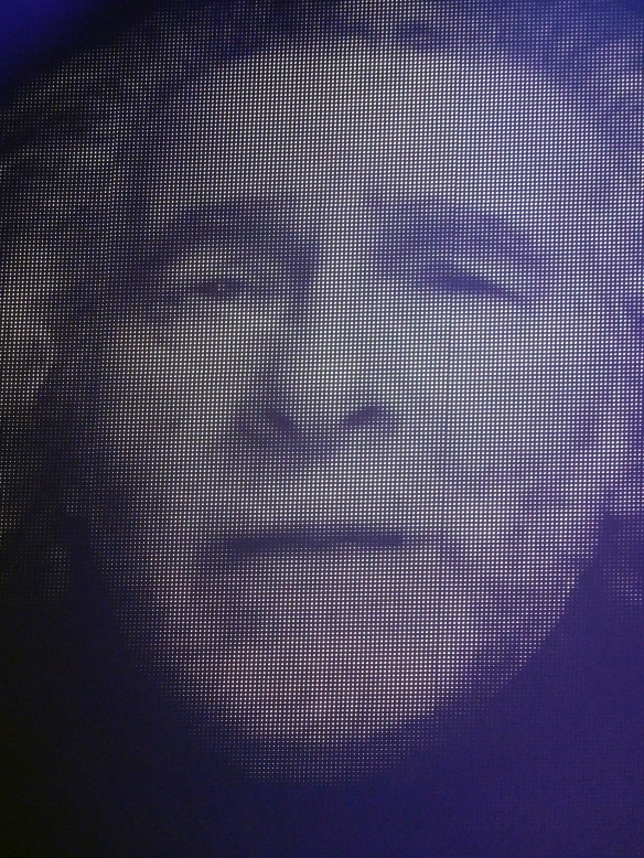 Kevin Godley, a ghostly presence on a video screen...