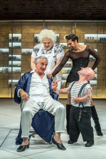 Henry Goodman (Volpone) with Jon Key as Nano, his dwarf supported by his entourage of Androgyno (Ankur Bahl) and Castrone (Julian Hoult)